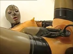 Girl in rubber masturbates