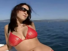 Bikini girl double penetration on a boat