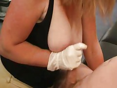 Great glove handjob with big tit action
