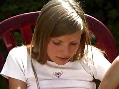 Nice teen playing alone in the garden