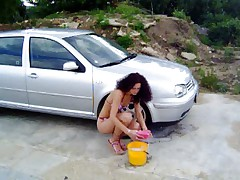 Andrea washing her car