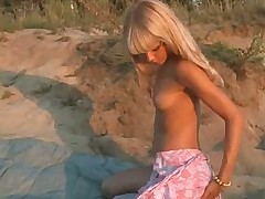 blonde on the beach showing her pussy