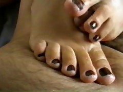 Bare footjob cum