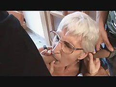 Gummy Granny in Glasses Plays with Two Cocks